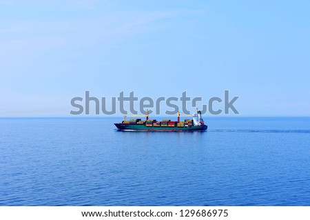 Cargo ship entering the port of Hamburg - stock photo