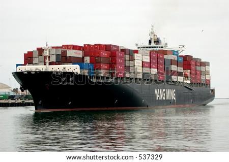 Cargo ship entering the port of Los Angeles. San Pedro, California. - stock photo