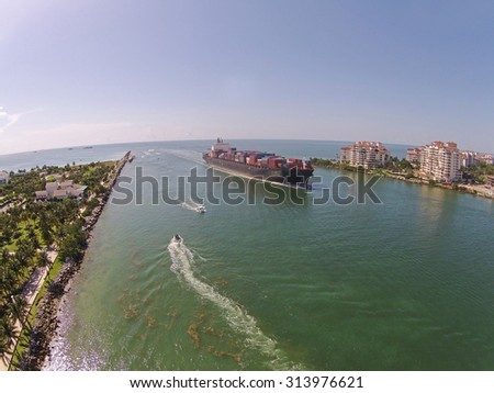 Cargo ship enters the Port of Miami seen from above - stock photo