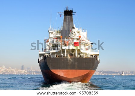 Cargo ship from the backwash - stock photo