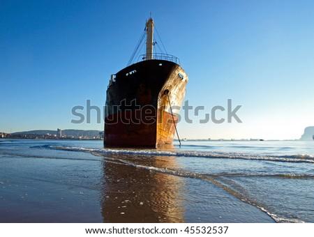 Cargo ship gotten suck on the beach of Algeciras, Spain - stock photo