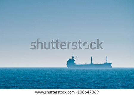 Cargo ship horizontal - stock photo