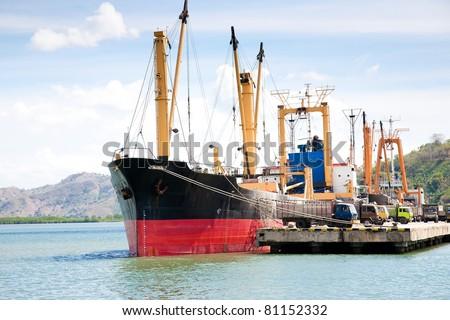 Cargo ship in a dock - stock photo