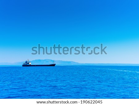 cargo ship in Greek waters at dodecanese islands - stock photo