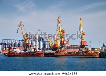 cargo ship in industrial port - stock photo