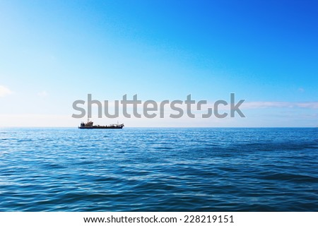 Cargo ship in ocean - stock photo