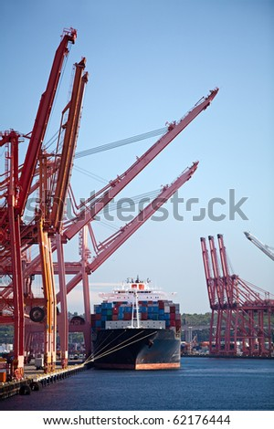 cargo ship in port - large container ship docked - stock photo