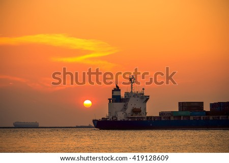 cargo ship in sunset
