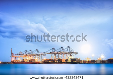 Cargo ship in the Trade Port, Shipping, Logistics, Transportation Systems, Container Cargo freight ship with working crane bridge in shipyard at twilight sky, Logistic Import Export background. - stock photo