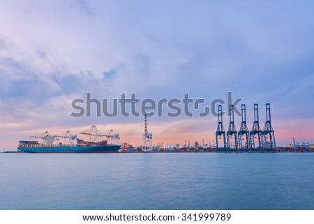 Cargo ship in Trade Port , Container loading Shipping by crane, Logistics , Transportation Systems - stock photo