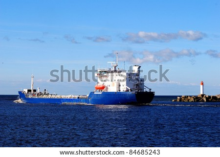 cargo ship leaving port. Ventspils, Lativa