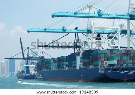 Cargo ship loading containers at the Port of Miami - stock photo