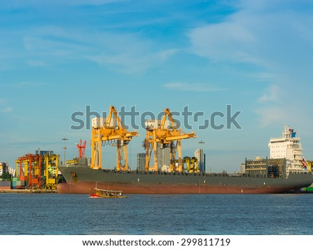 Cargo ship loading containers on schedule. - stock photo
