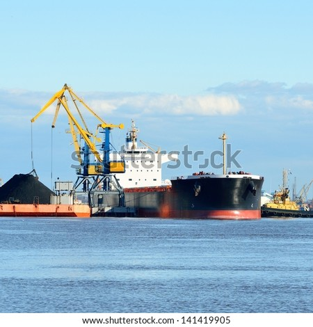 cargo ship loading in coal cargo terminal