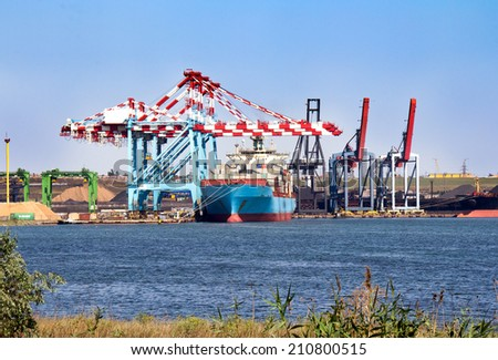 Cargo ship loading in the port  - stock photo