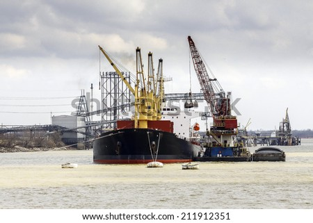 Cargo ship loading in the port. - stock photo