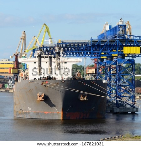 Cargo ship loading in the port of Ventspils - stock photo