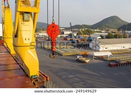 Cargo ship loading with port - stock photo