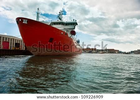 Cargo ship moored at the pier in Copenhagen - stock photo