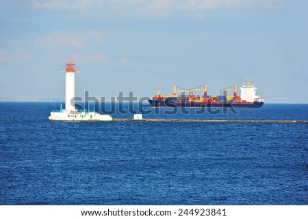 Cargo ship near lighthouse in Odessa, Ukraine
