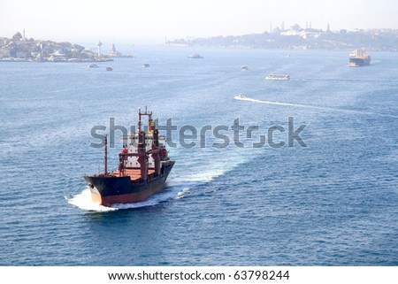 Cargo ship on Bosporus - stock photo