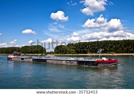 Cargo ship on Rhine river - stock photo