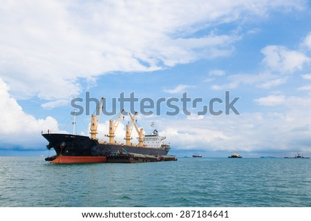 Cargo ship. Parking in the sea to await transportation to the port.