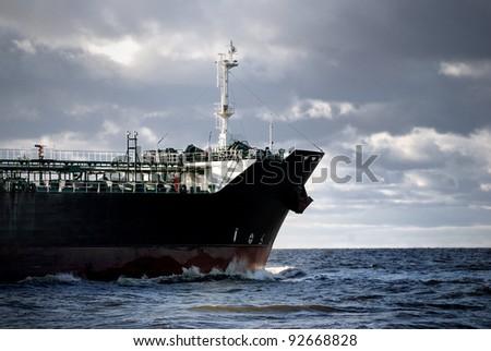 cargo ship's bow heading forward - stock photo