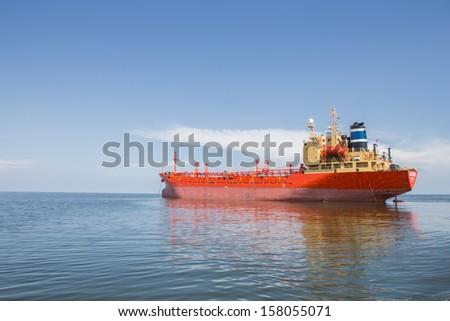 cargo ship sailing in still water near Bangkok Thailand - stock photo