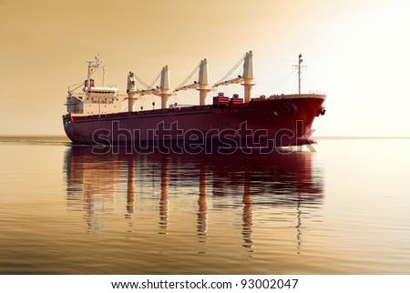 cargo ship sailing in still water near port of Riga - stock photo