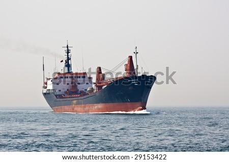 Cargo ship sailing the sea - stock photo