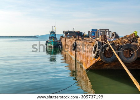 cargo ship. Ships, barges and small boats for sorting. - stock photo