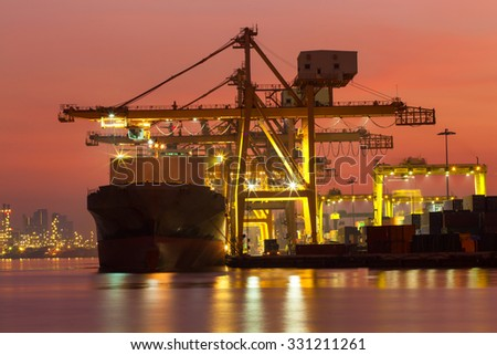 Cargo ship to light in the morning before sunrise. - stock photo