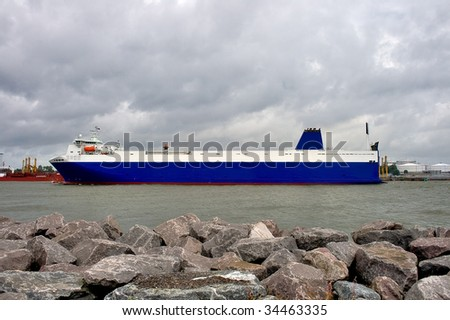 cargo ship transporting goods - stock photo
