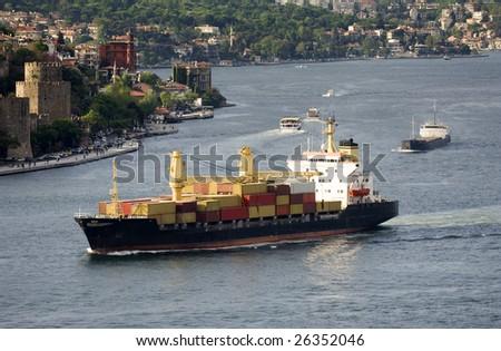 Cargo ship, Turkey-Istanbul-Bosphorus - stock photo