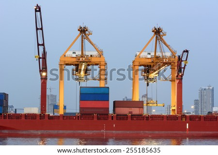 Cargo ship with stacked container at harbor terminal - stock photo