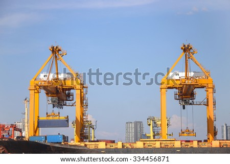 Cargo ship working with crane at port - stock photo