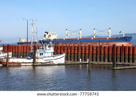 Cargo ships anchored in Astoria Oregon. - stock photo