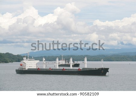 cargo ships anchored in panama canal - stock photo