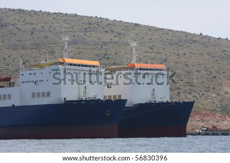 Cargo Ships anchored side by side in the harbour at Cesme, Turkey