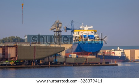 Cargo Ships Being Constructed on a Wharf in the Netherlands - stock photo