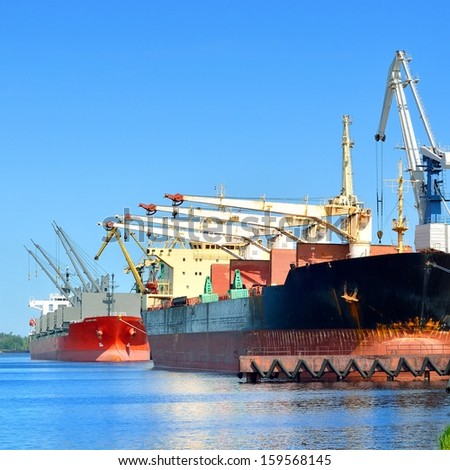 cargo ships loading in cargo terminal of Riga - stock photo