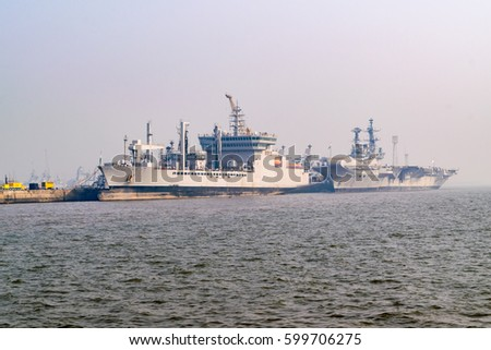 Cargo ships of commercial shipping at anchor in the Arabian Sea outside Mumbai, India's busiest port.