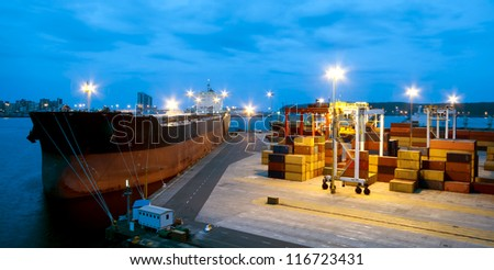 Cargo tanker ship moored in port - stock photo