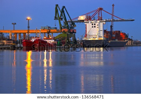 Cargo terminal at night in port Gdansk, Poland. - stock photo