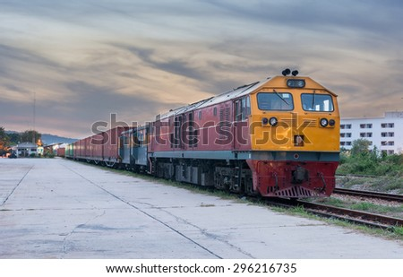 Cargo train and container at twilight of Thailand - stock photo