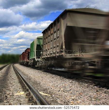 Cargo train in motion - stock photo