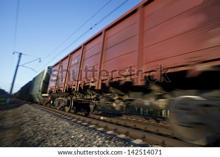 Cargo train moves on high speed - stock photo