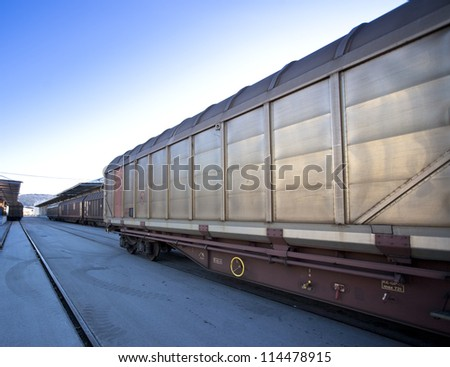 cargo train on dry dock close up steel wagon - stock photo