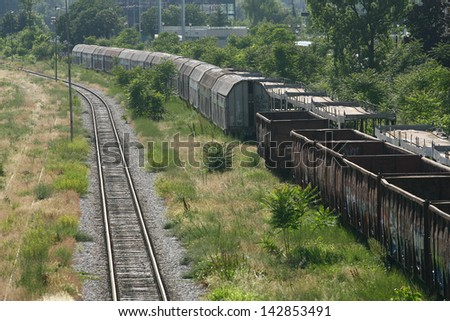 Cargo train platform railway tracks in a rural scene, Empty railway containers for transportation covered with a rust - stock photo
